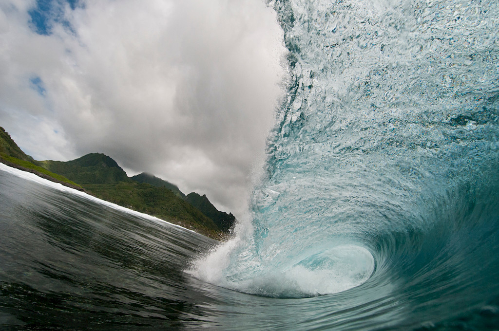 Breaking wave over a coral reef, Rarotonga, Cook Islands.